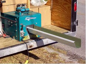 Sun Home Improvement uses an on-site gutter machine to roll aluminum oil stock into seemless gutters, custom made for your home.